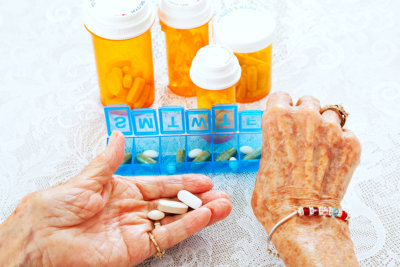 senior woman hands sorting her prescription medicine
